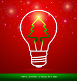 Merry Christmas tree in light bulb on red background Royalty Free Stock Photography