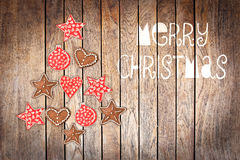 Merry Christmas, tree made with wooden rustic ornaments on wood background. Merry Christmas, tree made with wooden rustic ornaments on wood planks background Royalty Free Stock Image