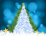Merry christmas tree snow and star on bokeh blue background. Stock Photo
