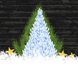 Merry christmas tree snow and star on bokeh blue background. Stock Photos