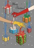 Merry Christmas. Two female hands with gifts royalty free stock images