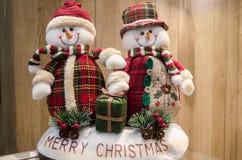 Merry Christmas. Two happy snowman dolls wishing everyone Merry Christmas Stock Photo