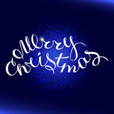 Merry Christmas type. The phrase Merry Christmas on a blue background and glittering texture explosion . Greeting card template with trend hand lettering. Vector vector illustration