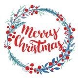 Merry Christmas type in wreath frame. Custom brush Stock Images