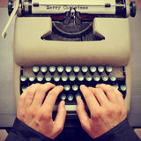 Merry christmas typewritten in a paper sheet on a typewriter, wi Royalty Free Stock Photo