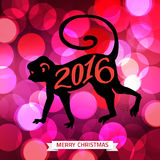 2016 Merry Christmas typographical shining background. With monkey silhuette and blurred bokeh lights . Chinese zodiac monkey, 2016 year of the monkey. Red Royalty Free Stock Images