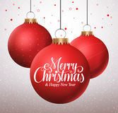 Merry christmas typography greetings in a hanging red christmas balls Royalty Free Stock Images