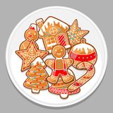 Merry Christmas various gingerbreads on white plate.  Royalty Free Stock Photography