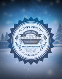 Merry christmas vector against snowy scene Royalty Free Stock Images