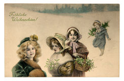 Merry Christmas vintage card. Germany - Circa 1910: Reproduction of antique greeting postcard printed in Germany shows a children who have a happy Christmas royalty free stock photography