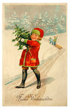 Merry Christmas vintage card. Germany - Circa 1910: Reproduction of antique greeting postcard printed in Germany shows a children who have a happy Christmas stock photo