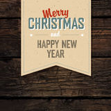 Merry Christmas VIntage Tag Design On Red Planks Royalty Free Stock Image