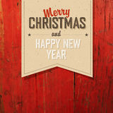 Merry Christmas VIntage Tag Design On Red Planks Stock Photo