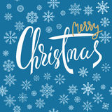 Merry Christmas white and gold lettering design with snowflakes on blue background. EPS10 Royalty Free Stock Photo