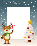 Merry Christmas White Tree - Reindeer. Christmas vertical photo frame with a Christmas tree and a happy reindeer smiling and holding a candy cane in a snowy Stock Photography