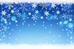Merry Christmas. Winter background with blue bokeh and snowflakes. Abstract Christmas holiday snow backdrop Royalty Free Stock Image
