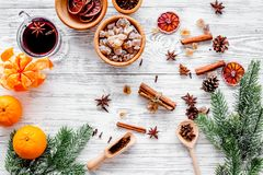 Merry christmas in winter evening with warm drink. Hot mulled wine or grog with fruits and spices on light background Royalty Free Stock Photos