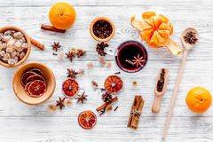 Merry christmas in winter evening with warm drink. Hot mulled wine or grog with fruits and spices on light background Stock Photo