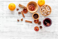 Merry christmas in winter evening with warm drink. Hot mulled wine or grog with fruits and spices on light background Royalty Free Stock Photography