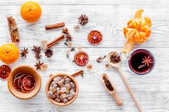 Merry christmas in winter evening with warm drink. Hot mulled wine or grog with fruits and spices on light background Stock Image