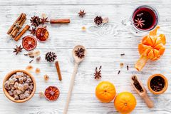 Merry christmas in winter evening with warm drink. Hot mulled wine or grog with fruits and spices on light background Royalty Free Stock Photo