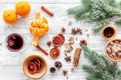 Merry christmas in winter evening with warm drink. Hot mulled wine or grog with fruits and spices on light background Stock Photos