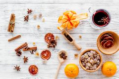 Merry christmas in winter evening with warm drink. Hot mulled wine, grog with fruits and spices on light background top Stock Photo