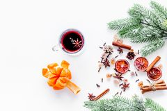 Merry christmas in winter evening with warm drink. Hot mulled wine or grog with fruits and spices on white background Stock Image
