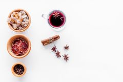Merry christmas in winter evening with warm drink. Hot mulled wine or grog with fruits and spices on white background Royalty Free Stock Image