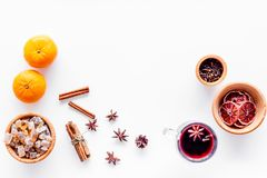 Merry christmas in winter evening with warm drink. Hot mulled wine or grog with fruits and spices on white background Stock Images