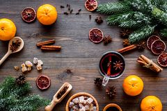 Merry christmas in winter evening with warm drink. Hot mulled wine or grog with fruits and spices on wooden background Royalty Free Stock Image