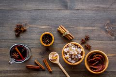 Merry christmas in winter evening with warm drink. Hot mulled wine or grog with fruits and spices on wooden background Stock Images