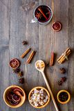 Merry christmas in winter evening with warm drink. Hot mulled wine or grog with fruits and spices on wooden background Stock Image