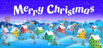 Merry christmas. Winter, snowy Christmas Eve with the image of the village with the smoke from the chimneys and drifts Royalty Free Stock Photography