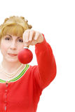 Merry Christmas with woman holding a red bauble Stock Image