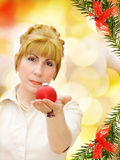 Merry Christmas! - woman with red bauble Royalty Free Stock Images