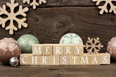 Merry Christmas wooden blocks with decor on rustic wood Royalty Free Stock Photos