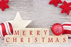 Merry Christmas wooden blocks with red decor Royalty Free Stock Photography