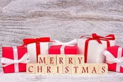 Merry Christmas wooden blocks with red and white gift boxes Royalty Free Stock Images