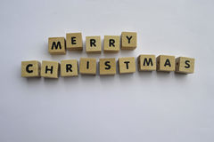 Merry Christmas. Wooden blocks spelling the words merry christmas Stock Photos
