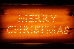 Merry christmas on a wooden board Stock Images