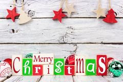 Merry Christmas wooden letters over rustic white wood Royalty Free Stock Photo