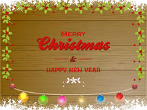 Merry Christmas wooden panel and lights Royalty Free Stock Images