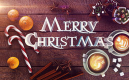 Merry Christmas. Wooden table with Christmas set and text Royalty Free Stock Images