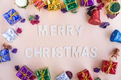 Merry christmas wooden word with colourful christmas gift boxe stock image