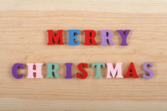 MERRY CHRISTMAS word on wooden background composed from colorful abc alphabet block wooden letters, copy space for ad Stock Image