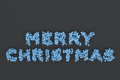 Merry Christmas words from blue balls on black background. Christmas sign. 3D rendering illustration Royalty Free Stock Photos