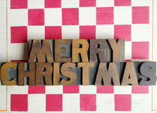 Merry Christmas words on checkerboard Stock Photo