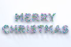 merry christmas words from colorful balls on white background royalty free illustration