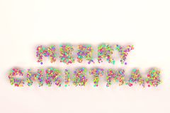 merry christmas words from colorful balls on white background stock image